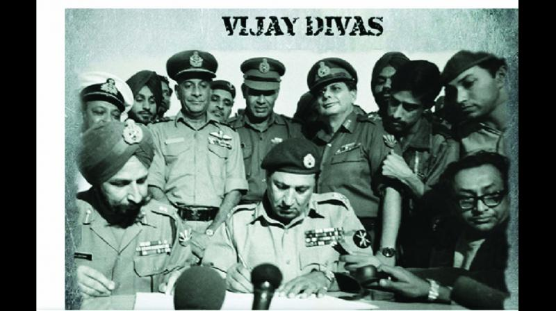 A file photo of Lt. Gen. A.A.K. Niazi, commander of all Pakistani forces in the eastern theatre, signing the instrument of surrender, as Lt. Gen. Jagjit Singh Aurora, GOC-in-C of India's Eastern Command and commander of the joint India-Bangladesh forces, looks on at the Ramna Race Course in Dhaka on December 16, 1971. Seated on extreme right is All India Radio's Surajit Sen, who was the first foreign correspondent to reach Dhaka.