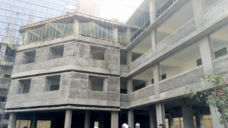 The school building under construction.