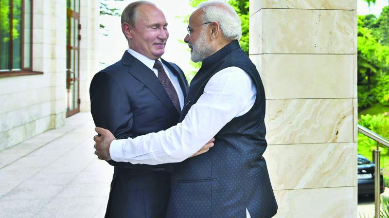 Prime Minister Narendra Modi meets Russian President Vladimir Putin in Sochi, Russia. (Photo: PTI)