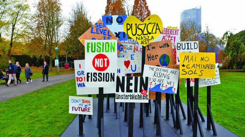 Placards with slogans at Rheinaue park during the COP23 UN Climate Change Conference in Bonn, Germany. (Photo: AFP)