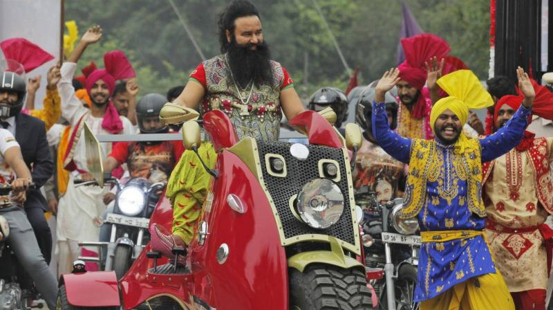 The inmate who is now out on bail also averred that a special vehicle brings food for Ram Rahim and that the authorities also cut out portions from newspapers which castigate the jail administration. (Photo: AP)