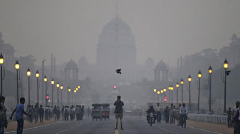 Country's environment minister Harsh Vardhan contrasted the pollution choking large swathes of north India, including the capital, with the 1984 gas leak in Bhopal that killed at least 25,000 people and remains the world's worst industrial disaster. (Photo: AP)