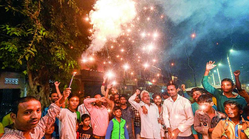 Residents of Sadatganj area in Ayodhya burst fire crackers outside their houses on Saturday to celebrate the Supreme Court's judgement to give dispute land to Hindus for the construction of a Ram temple, ending decades-long litigation. (Photo: PTI)