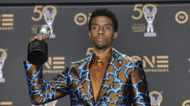 Chadwick Boseman poses in the press room with the award for outstanding actor in a motion picture for