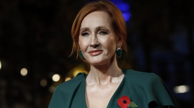 J.K. Rowling poses for the media at the world premiere of the film