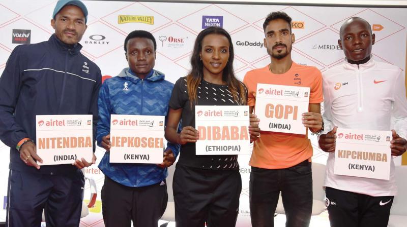 Elite athletes Nitendra Singh Rawat (from left), Joyciline Jepkosgei, Tirunesh Dibaba, Gopi Thonakal and Daniel Kipchumba in New Delhi on Saturday, the eve of the Airtel Delhi Half marathon.