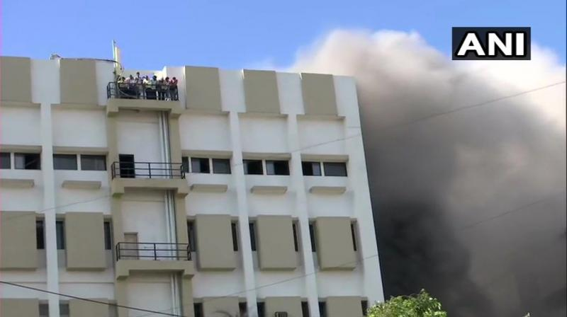 Almost a 100 people are estimated to be trapped in the building. (Photo: ANI)