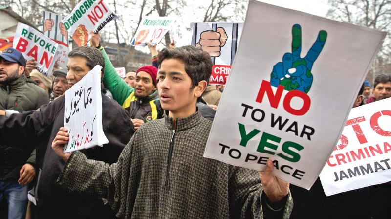 Kashmiri supporters of the Peoples Democratic Party (PDP) shout slogans against banning of Jama'at-e-Islami, the largest  political and religious group in Kashmir. (Photo: PTI)