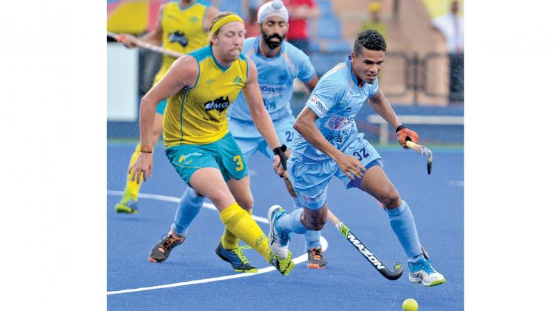 Shilanand Lakra (right) in action against Australia in their Azlan Shah Cup in Ipoh, Malaysia, on Tuesday.