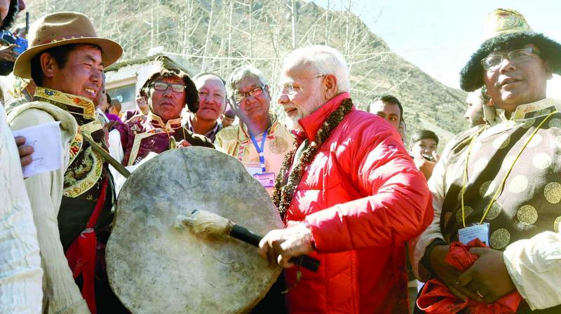 Prime Minister Narendra Modi beats a drum at Muktinath Temple in Nepal's Mustang district. (Photo: PTI)