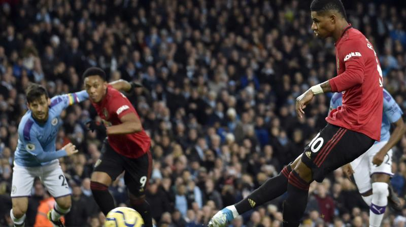 Manchester United's Marcus Rashford opened the scoring from the penalty spot in the 23rd minute and Anthony Martial doubled the visitors' lead six minutes later. Manchester City came back strongly and eventually their pressure paid off, with Nicolas Otamendi's late header sparking a frantic wave of City attacks but they failed to find an equaliser and United moved up to fifth in the table. (Photo:AP)