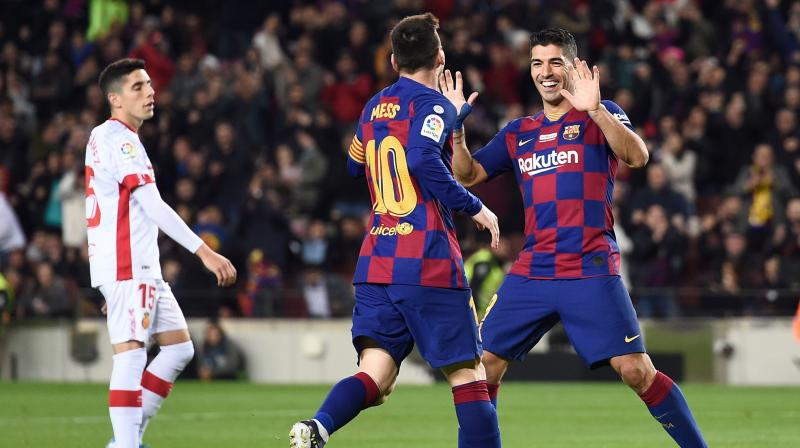 Lionel Messi broke yet another record by hitting his 35th La Liga hat-trick as Barcelona thrashed Real Mallorca 5-2 to keep pace with Real Madrid at the top of the table. (Photo:AFP)