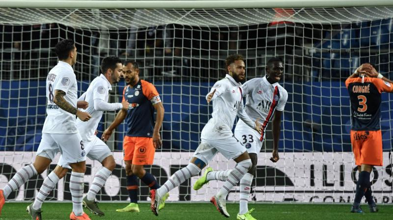 Neymar scored a sublime free-kick and set up another goal as Paris Saint-Germain rallied to beat 10-man Montpellier 3-1 and restore their lead at the top of Ligue 1 to eight points. (Photo:AFP)