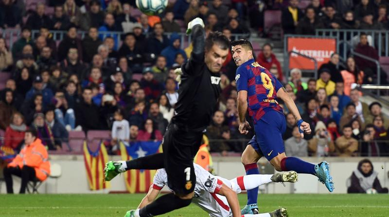 Barcelona's Luis Suarez is exhilarated after scoring his career's best goal against RCD Mallorca on Sunday. (Photo:AFP)