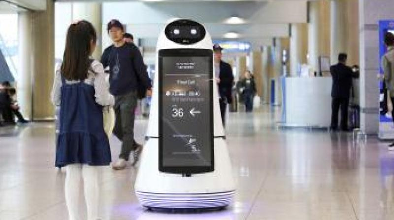 Troika, a robot made by LG Electronics, serves visitors at Incheon International Airport in South Korea on April 10. Photo: AP