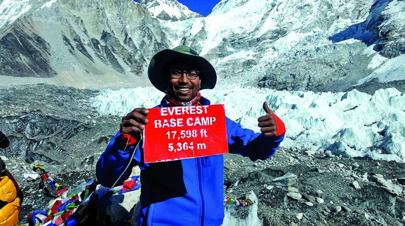 Sujit atop the Everest Base Camp