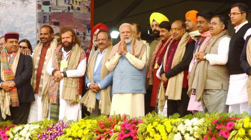 Prime Minister Narendra Modi with BJP leaders Manoj Tiwari, Vijay Goel, Hansraj Hans and others during a rally at Ramlila Maidan in New Delhi on Sunday. (Photo: PRITAM BANDYOPADHYAY)