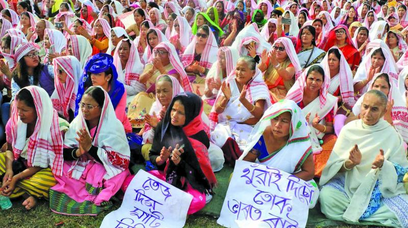Women sit on a protest during a demonstration against the Citizenship Amendment Act and NRC in Namrup, Assam, on Sunday. (Photo: PTI)