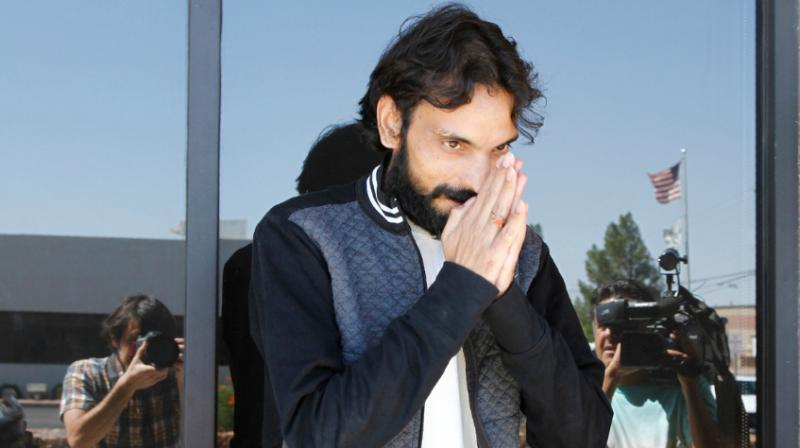 Ajay Kumar, 33, bowed with his hands clasped together in a traditional Indian greeting as he walked away from a detainee processing centre in El Paso.  (Photo: AP)