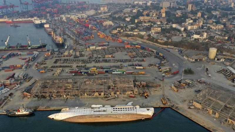 A sunken cruise ship caused by Aug. 4 explosion that hit the seaport of Beirut, Lebanon, sits in the water. The Lebanese military discovered more than 4 tons of ammonium nitrate near Beirut's port on Thursday, Sept. 3, a find that's a chilling reminder of the horrific explosion a month ago that killed 191 people. (AP)