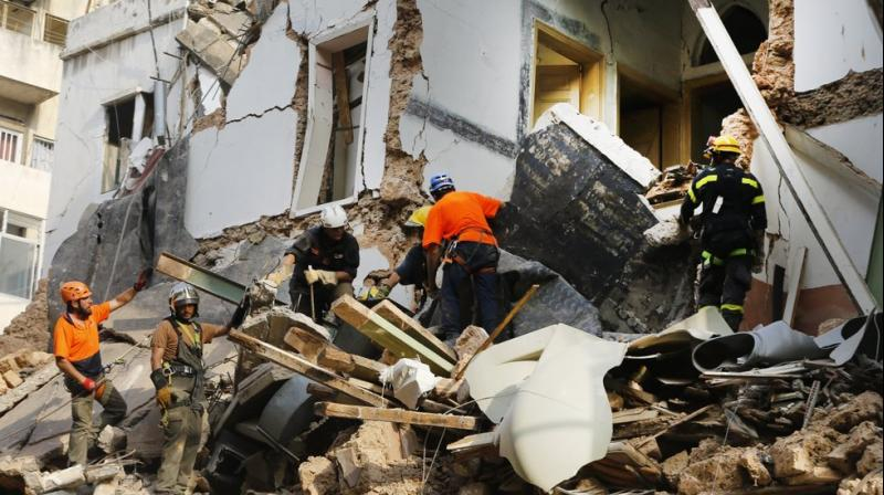 Chilean and Lebanese rescuers search in the rubble of a building that was collapsed in last month's massive explosion, after getting signals there may be a survivor under the rubble, in Beirut, Lebanon. (AP)