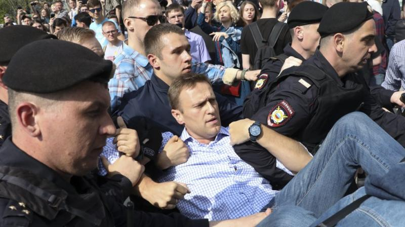 Russian police carry opposition leader Alexei Navalny, center, from a demonstration against President Vladimir Putin in Pushkin Square in Moscow, Russia. (AP File)