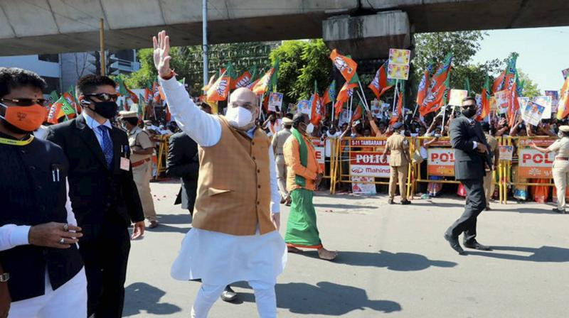 Union Home Minister Amit Shah waves at supporters in Chennai. (PTI)