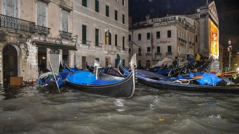Photos on social media showed taxi boats and gondolas grounded on walkways flanking city canals. (Photo: AP)