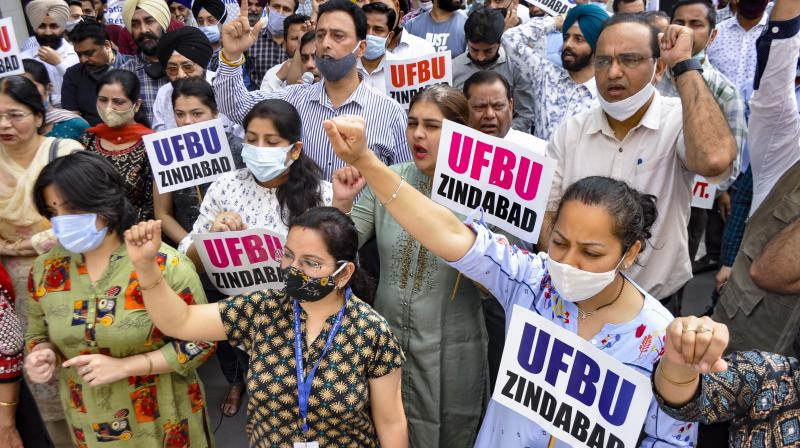 Members of Bank Unions hold a protest during their two-day nationwide strike against the privatisation of Public Sector Banks and alleged retrograde banking reforms, in Patiala, Monday, March 15, 2021. (PTI)