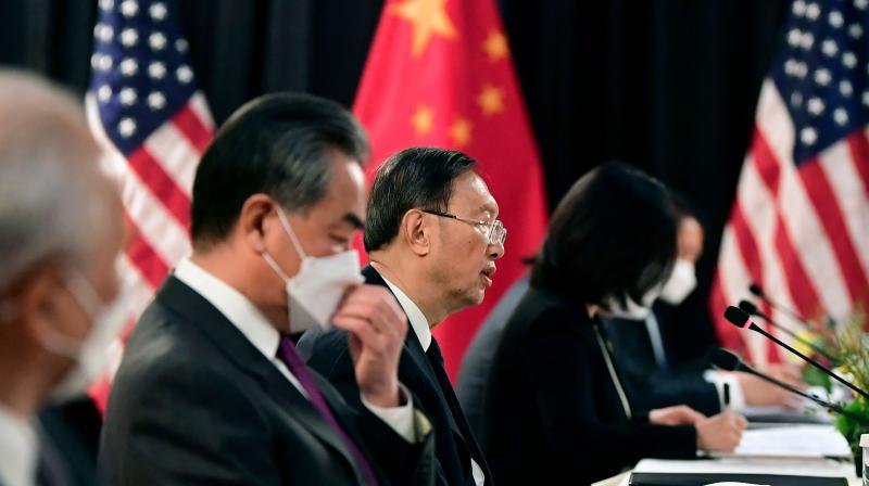 The Chinese delegation led by Yang Jiechi (C), director of the Central Foreign Affairs Commission Office and Wang Yi (2nd L), China's Foreign Minister, speak with their US counterparts at the opening session of US-China talks at the Captain Cook Hotel in Anchorage, Alaska on March 18, 2021. - China's actions