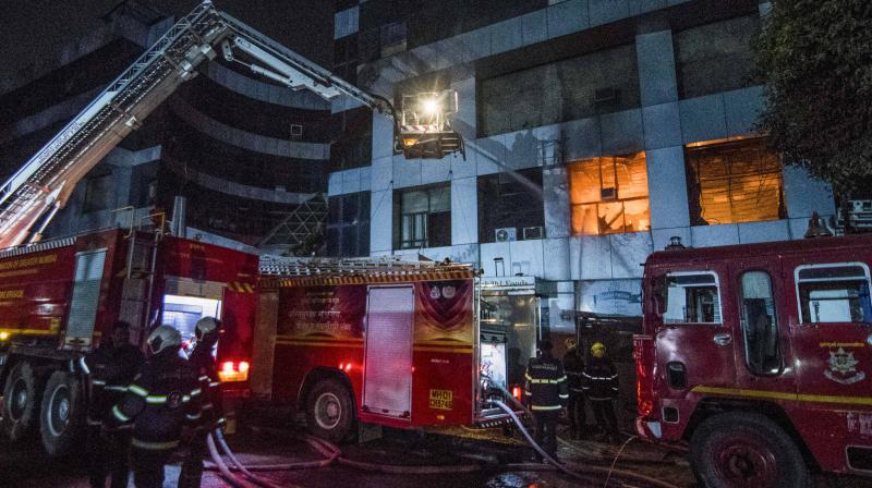 Firefighters attempt to douse a blaze at Dreams Mall, affecting patients admitted in the nearby COVID-19 dedicated Sunrise Hospital, in Mumbai, early Friday, March 26, 2021. (PTI)