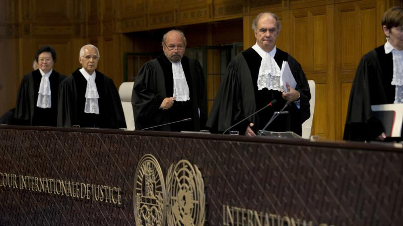 Presiding judge Ronny Abraham of France, center, enters to read the World Court's verdict in the case brought by India against Pakistan in The Hague, Netherlands. (Photo: AP)