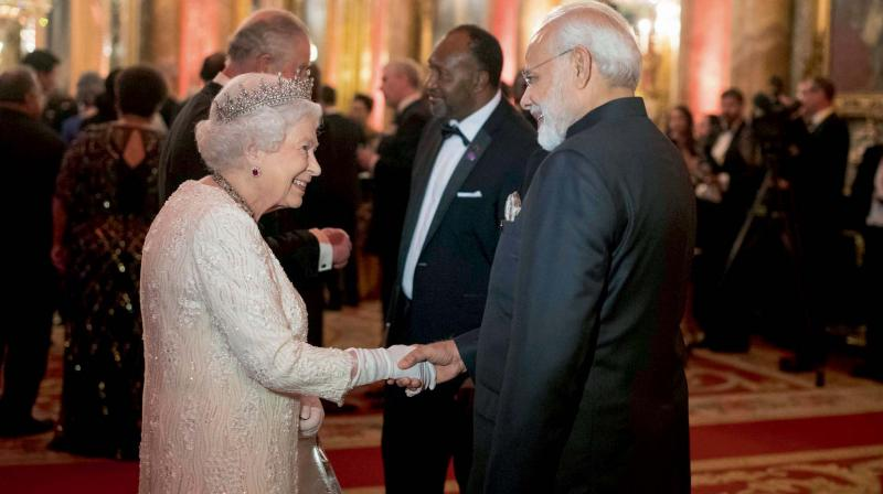Britain's Queen Elizabeth II greets Prime Minister Narendra Modi in the Blue Drawing Room at Buckingham Palace in London. (Photo: AP)