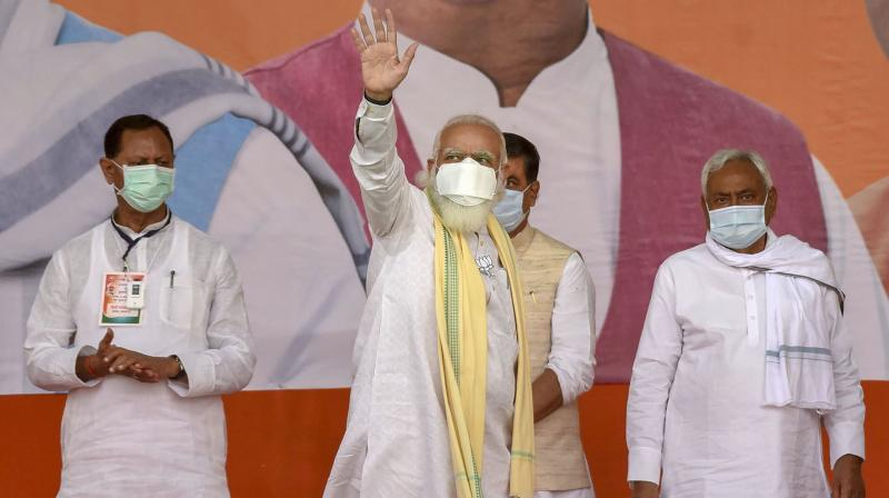Prime Minister Narendra Modi with Bihar Chief Minister and Janta Dal-United President Nitish Kumar during an election rally, in Sasaram, Friday, Oct. 23, 2020. (PTI)