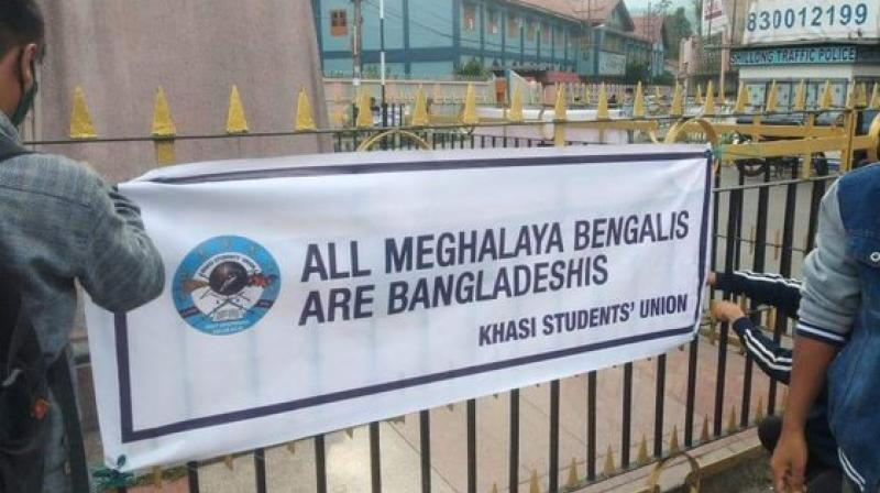 """The banners and posters, reading """"All Meghalaya Bengalis are Bangladeshis"""", were alleged to have been put up by the KSU.(Twitter/@MrSamratX)"""