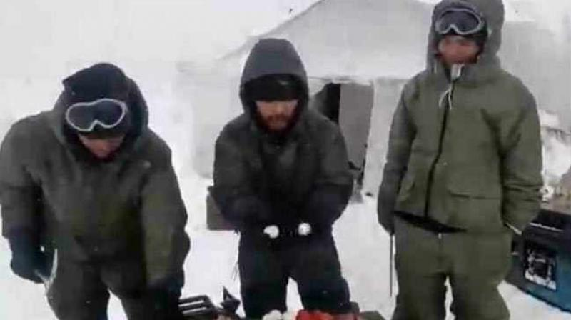 In a video that has gone viral, a few soldiers posted in Siachen demonstrate how hard it is for them to cook or consume food in the extremely cold weather conditions. (Photo: Facebook Screengrab | @IMA.Dehradun.Uk)
