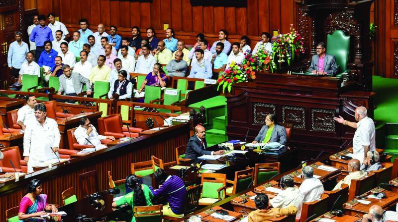 Former chief minister B.S. Yeduyurappa (right) argues with former chief minister and Congress-JD(S) coordination committee chairman Siddaramaiah and minister D.K. Shivakumar at Vidhana Soudha in Bengaluru on Tuesday. (Photo: PTI)