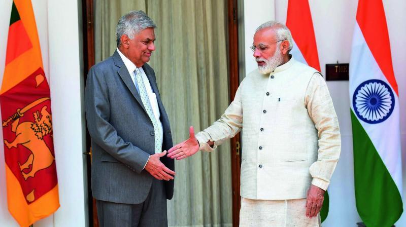 Prime Minister Narendra Modi shakes hands with his Sri Lankan counterpart Ranil Wickremesinghe in New Delhi. (Photo: PTI)