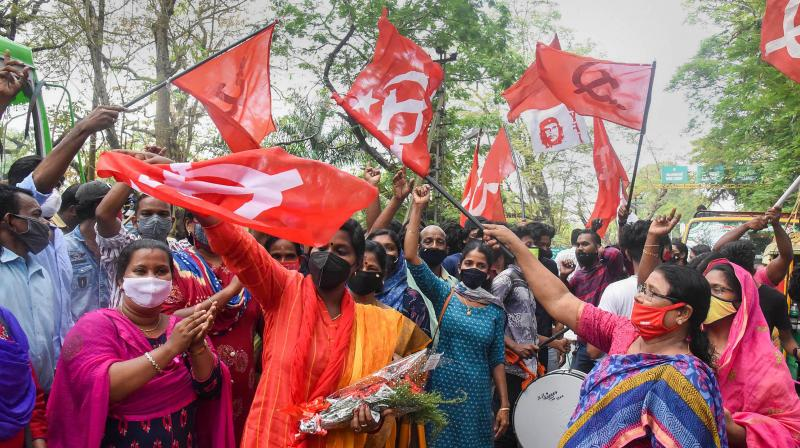 Left Democratic Front (LDF) supporters celebrate their party's lead in the Kerala local body elections in Kochi on Wednesday, December. 16, 2020. (PTI)