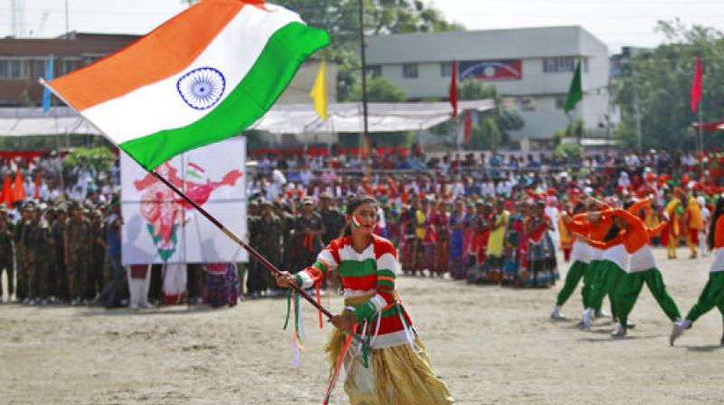 A student wave the Indian national flag as she performs during India's Independence Day celebrations, in Jammu, India, Tuesday, Aug. 15, 2017. (Photo: AP)