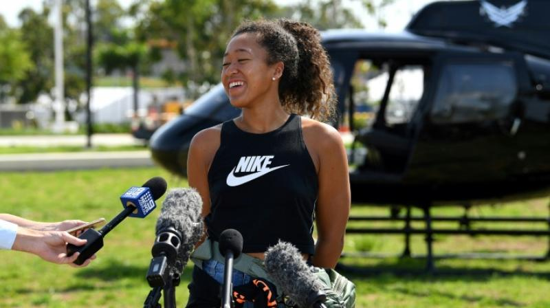 Tennis players typically use the off-season to rest and recover from their punishing schedules but two-time Grand Slam champion Naomi Osaka says she suffered a 'near-death experience' while paddleboarding with her sister in the Caribbean. (Photo:AFP)