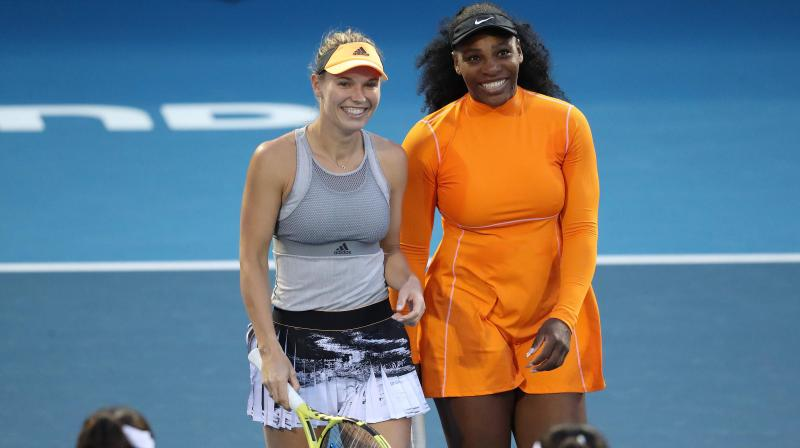 Serena Williams and Caroline Wozniacki teamed up in the doubles for the first time to beat Japanese pair Nao Hibino and Makoto Ninomiya 6-2 6-4 at the Auckland Classic on Monday. (Photo:AFP)