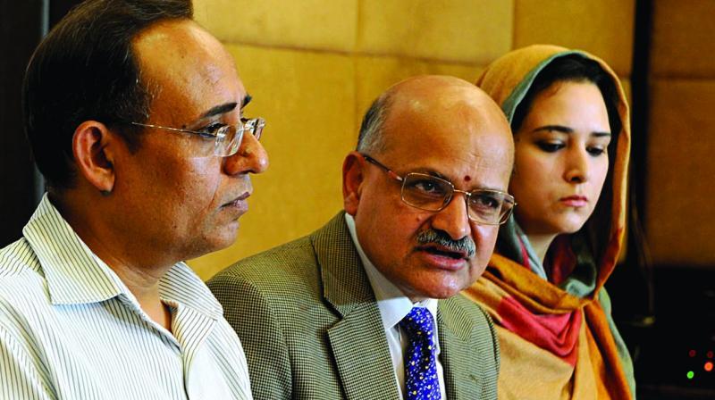 J&K chief secretary B.V.R. Subrahmanyam (centre) addresses the media in Srinagar. (Photo: H.U. Naqash)