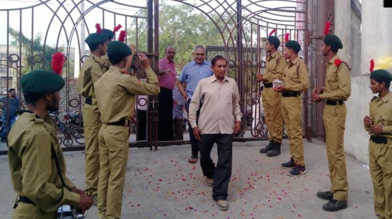 National Cadet Corps (NCC) volunteers beat drums and showered flower petals to greet voters as they reached a polling station under the Baghpat Lok Sabha seat in Uttar Pradesh on Thursday morning. (Photo: ANI | Twitter)