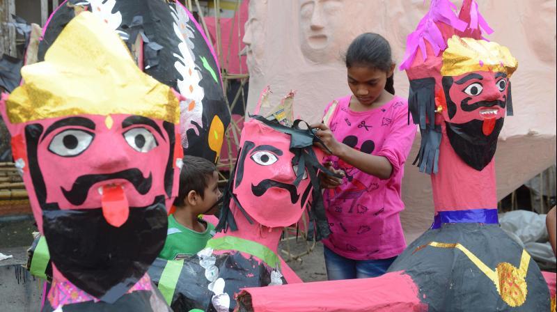 Indian Girl makes effigies of the Hindu demon king Ravana at a workshop ahead of the Hindu festival of Dussehra, in Amritsar on October 14, 2018. (Photo: AFP)
