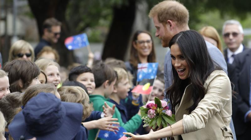 Britain's Prince Harry and Meghan, Duchess of Sussex greet children during a visit to Albert Park Primary School in Melbourne, Australia, Thursday, Oct. 18, 2018. (Photo: AP)