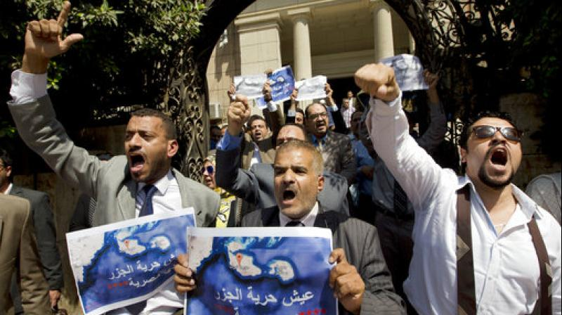 Dozens of lawyers shout slogans during a protest against the accord to hand over control of two strategic Red Sea islands, Tiran and Sanafir, to Saudi Arabia in front of the lawyers syndicate in Cairo. (Photo: AP)