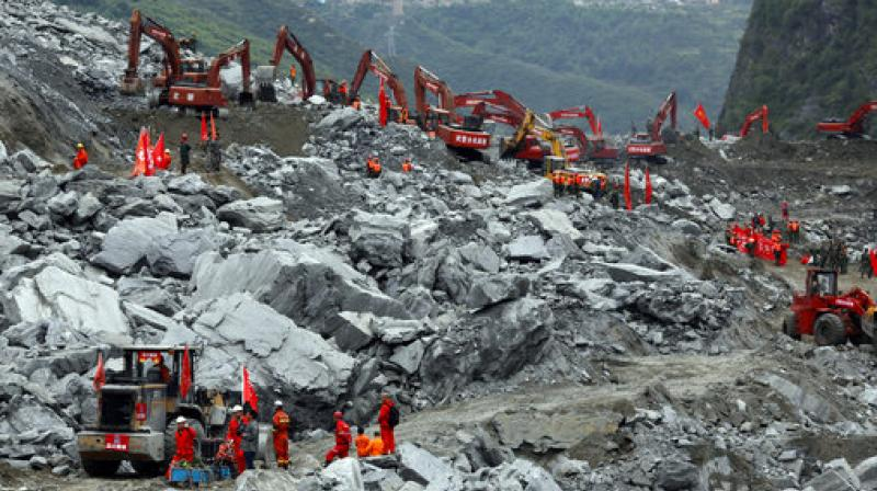 Heavy machinery is deployed to move debris during the search for victims at the site of a landslide in Maoxian County in southwestern China's Sichuan Province. (Photo: AP)