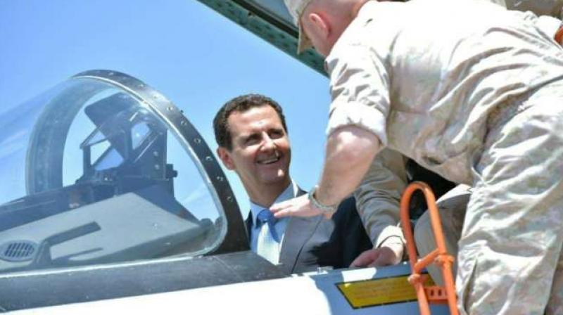 President Bashar al-Assad inside an Su-27 fighter jet during a visit to the Hmeimim military base in Latakia province. (Photo: AFP)