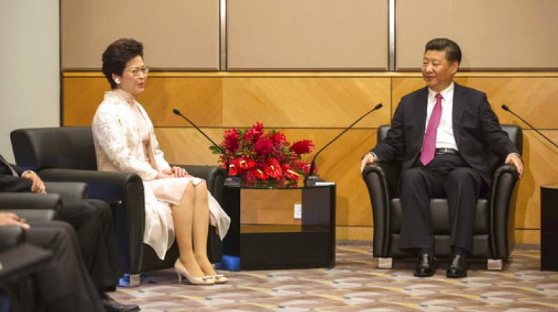 Chinese President Xi Jinping poses with Hong Kong's new Chief Executive Carrie Lam ahead of a meeting in Hong Kong. (Photo: AP)